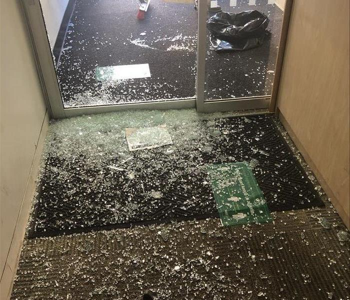 Broken glass all over the floor of a business