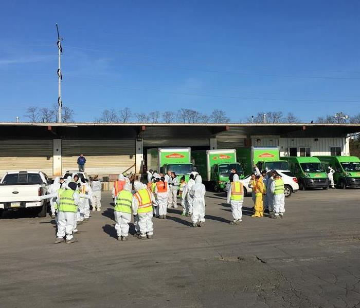 SERVPRO team in PPE preparing do a cleaning job