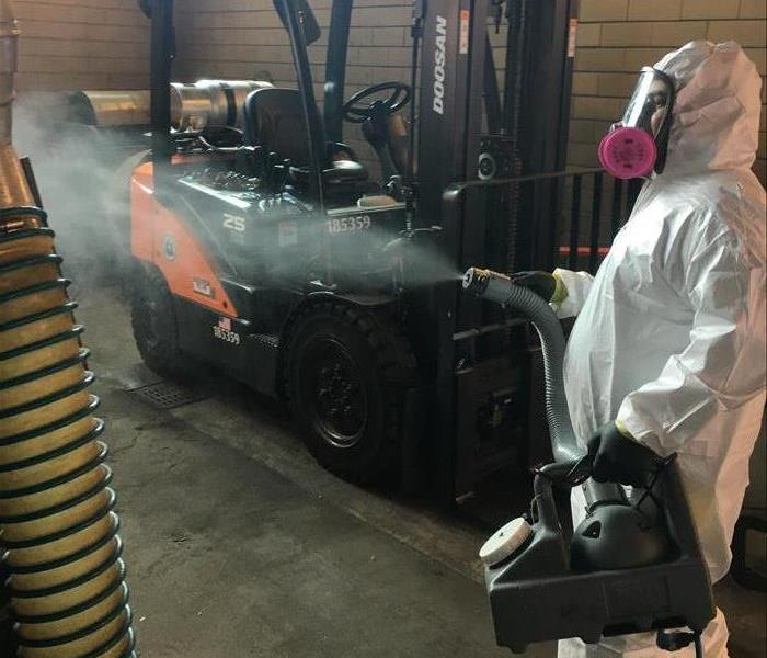 SERVPRO technician disinfecting a business